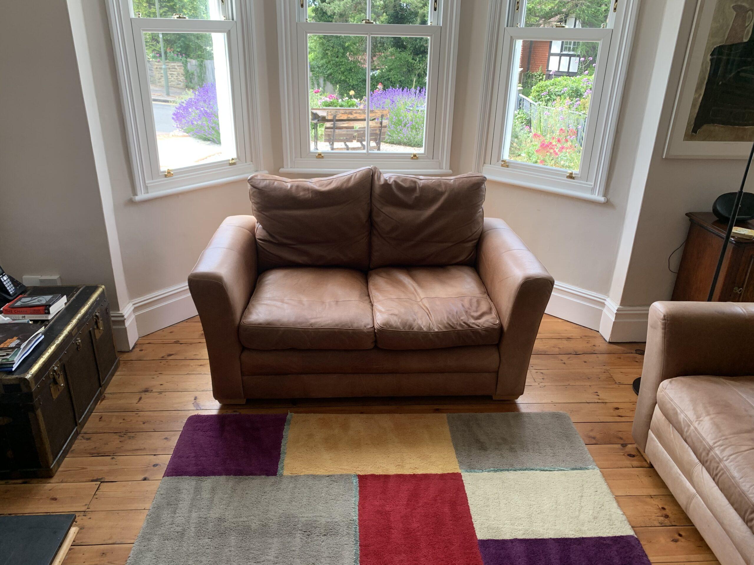 Brown Sofa Under Window